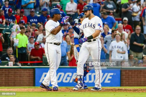 Texas Rangers third baseman Joey Gallo gets a high five from third baseman Adrian Beltre after hitting a home run during the game between the Texas...