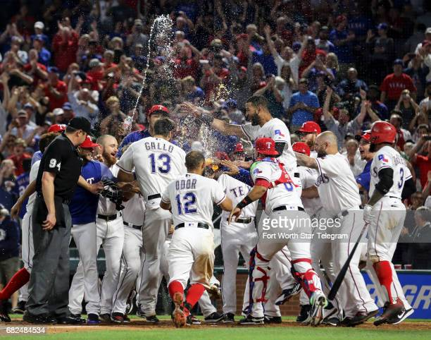 Texas Rangers third baseman Joey Gallo gets mobbed at the plate by his teammates after a threerun home run in the ninth inning to beat the Oakland...