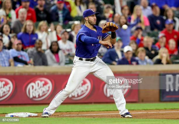 Texas Rangers third baseman Joey Gallo throws over to second base to complete a doubleplay during the MLB game between the Minnesota Twins and Texas...