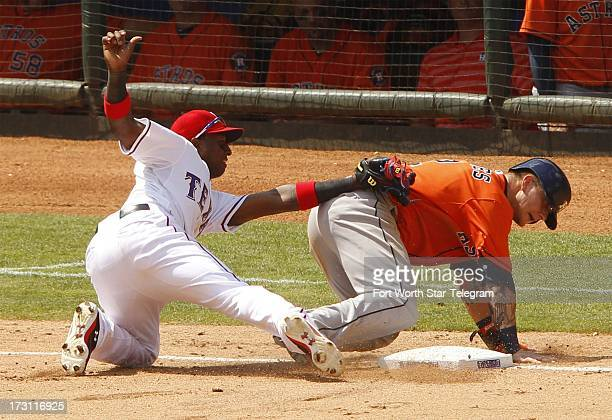 Texas Rangers third baseman Jurickson Profar tries to tag out Houston Astros Brandon Barnes without the ball on a pickoff attempt in the fifth inning...