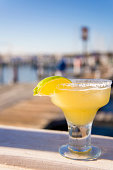 USA, Texas, Rockport, Glass of margarita cocktail in marina bar