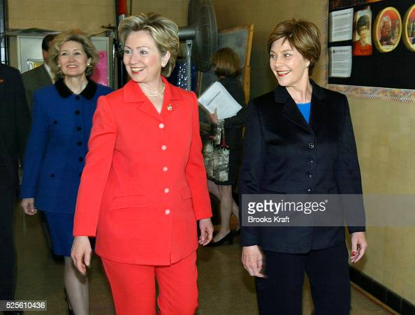 Texas Senator Kay Bailey Hutchison New York Senator Hillary Rodham Clinton and First Lady Laura Bush smiling during an event to announce new programs...