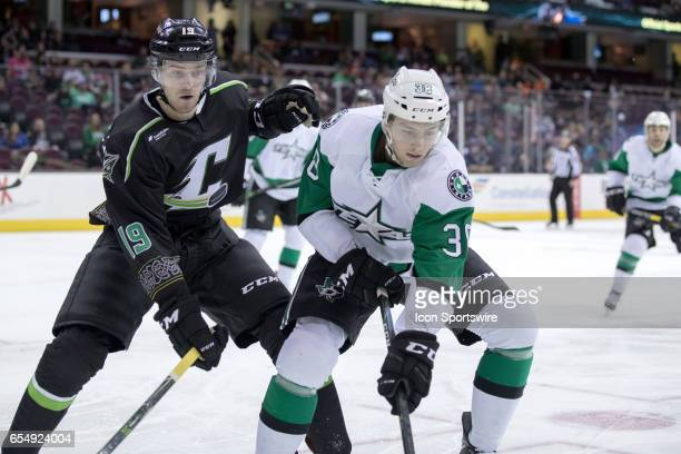 Texas Stars C Jason Dickinson plays the puck along the boards as Cleveland Monsters C Sam Vigneault defends during the second period of the AHL...