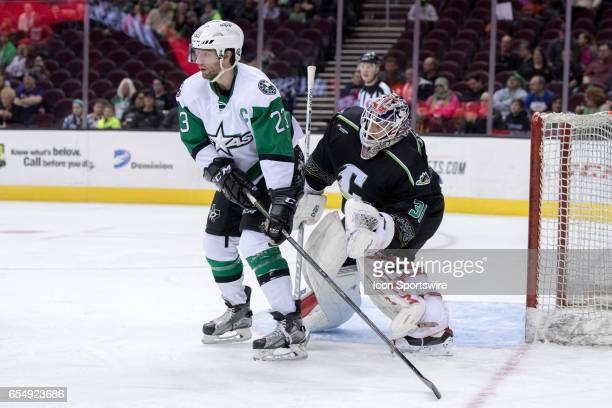Texas Stars C Travis Morin screens Cleveland Monsters G Anton Forsberg during the first period of the AHL hockey game between the Texas Stars and...