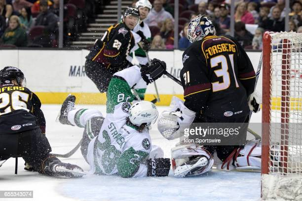 Texas Stars RW Matej Stransky makes contact with Cleveland Monsters G Anton Forsberg after being taken down by Cleveland Monsters D Jaime Sifers...