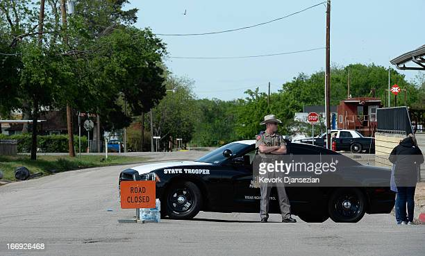 Texas State Trooper stops people from entering the neighberhood around the West Fertilizer Company April 18 2013 in West Texas A fiery explosion that...