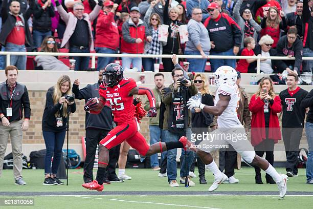 Texas Tech defensive back Douglas Coleman run the ball in for a touchdown after a fumble during the game between Texas Longhorns and Texas Tech Red...