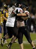 Texas Tech defensive end Keyunta Dawson and linebacker Mike Smith celebrate during 4531 victory over Cal in the Pacific Life Holiday Bowl at Qualcomm...