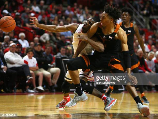 Texas Tech guard Keenan Evans and Texas Forward Mareik Isom fight for a loose ball during the Texas Tech University Red Raider's 6757 victory over...