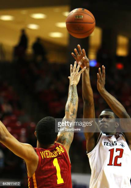 Texas Tech guard Keenan Evans shoots over Iowa State Guard Nick WeilerBabb during the Texas Tech University Red Raider's 8280 overtime loss to the...