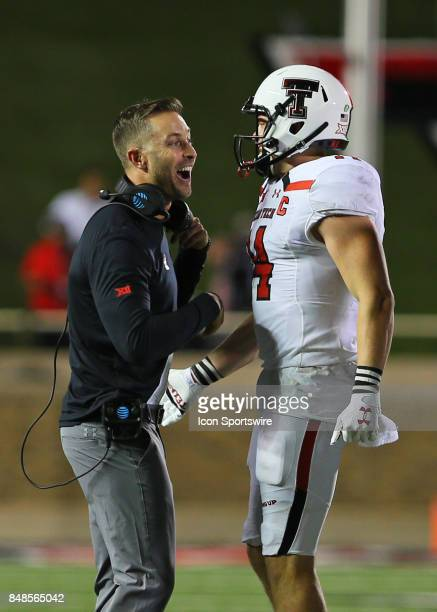 Texas Tech head coach Kliff Kingsbury and wide receiver Dylan Cantrell celebrate a touchdown during the Texas Tech Raider's 5245 victory over the...