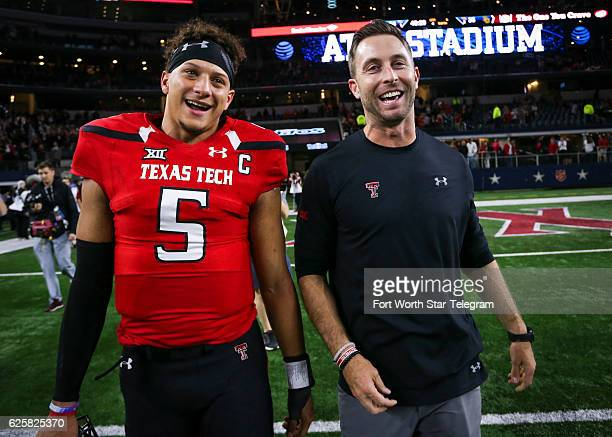 Texas Tech quarterback Patrick Mahomes II and head coach Kliff Kingsbury walk off the field after after a 5435 win against Baylor at ATT Stadium in...