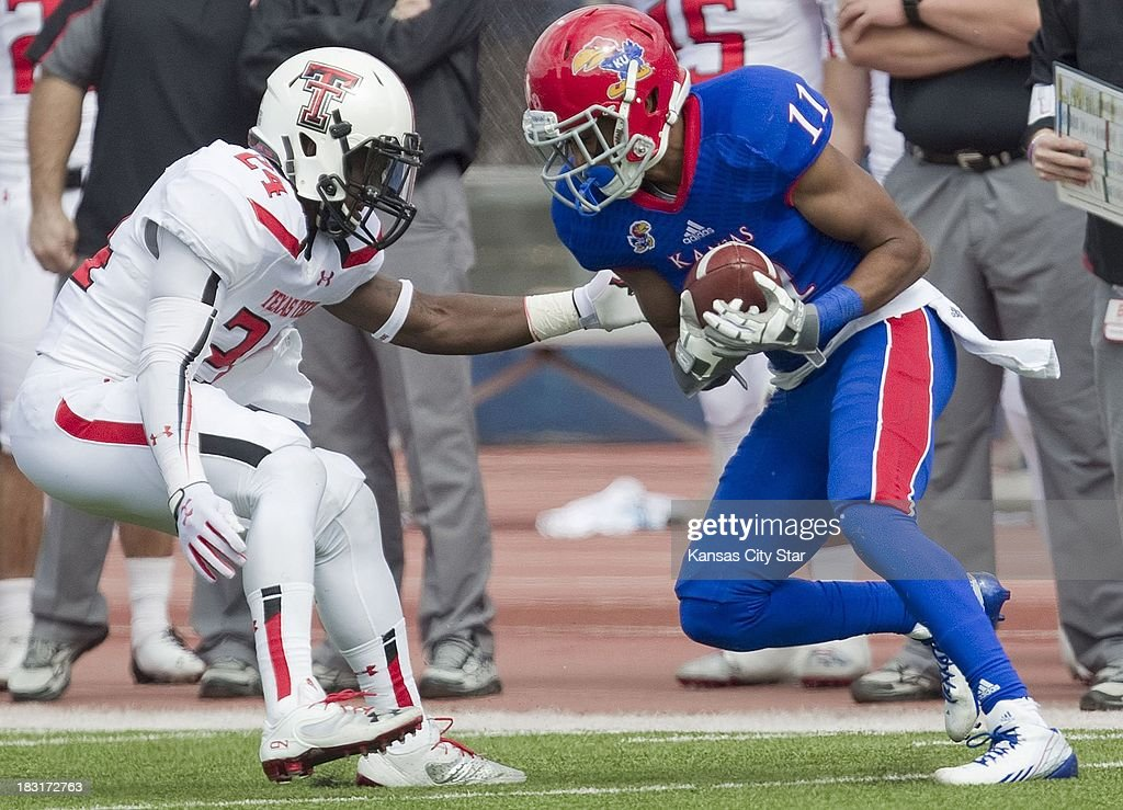 Texas Tech Red Raiders defensive back Bruce Jones (24) defends as Kansas Jayhawks wide receiver Tre' Parmalee (11) catches a pass during the second half at Memorial Stadium in Lawrence, Kansas, Saturday, October 5, 2013. Texas Tech defeated Kansas, 56-16.