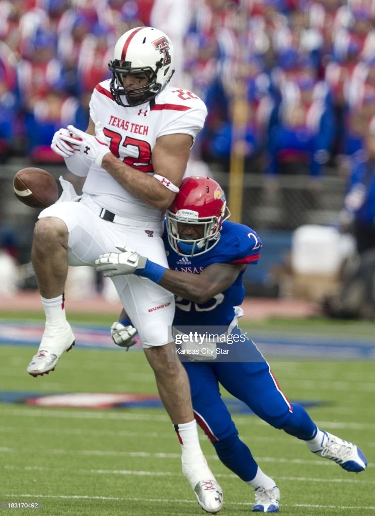 Texas Tech Red Raiders tight end Jace Amaro (22) loses control of a pass as Kansas Jayhawks safety Dexter Linton (23) tackles him during the first half at Memorial Stadium in Lawrence, Kansas, Saturday, October 5, 2013. Texas Tech defeated Kansas, 56-16.
