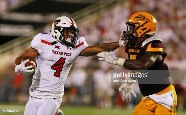 Texas Tech running back Justin Stockton stiffarms a defender during the Texas Tech Raider's 5245 victory over the Arizona State Sun Devils on...