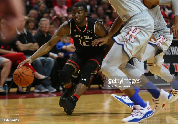 Texas Tech University guard Keenan Evans drives on two University of Kansas defenders during the Texas Tech University Red Raider's 7980 loss to the...