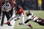 Texas Tech's Darrin Moore beats Minnesota's Michael Carter on a firstdown reception during the second quarter of the Meineke Car Care Bowl of Texas...