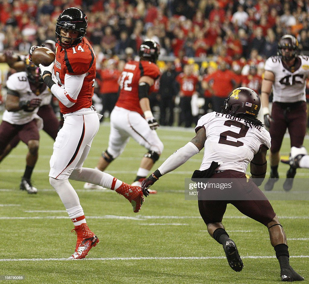 Texas Tech's Darrin Moore, left, pulls down a pass during the second quarter against Minnesota of the Meineke Car Care Bowl of Texas on Friday, December 28, 2012, at Reliant Stadium in Houston, Texas.
