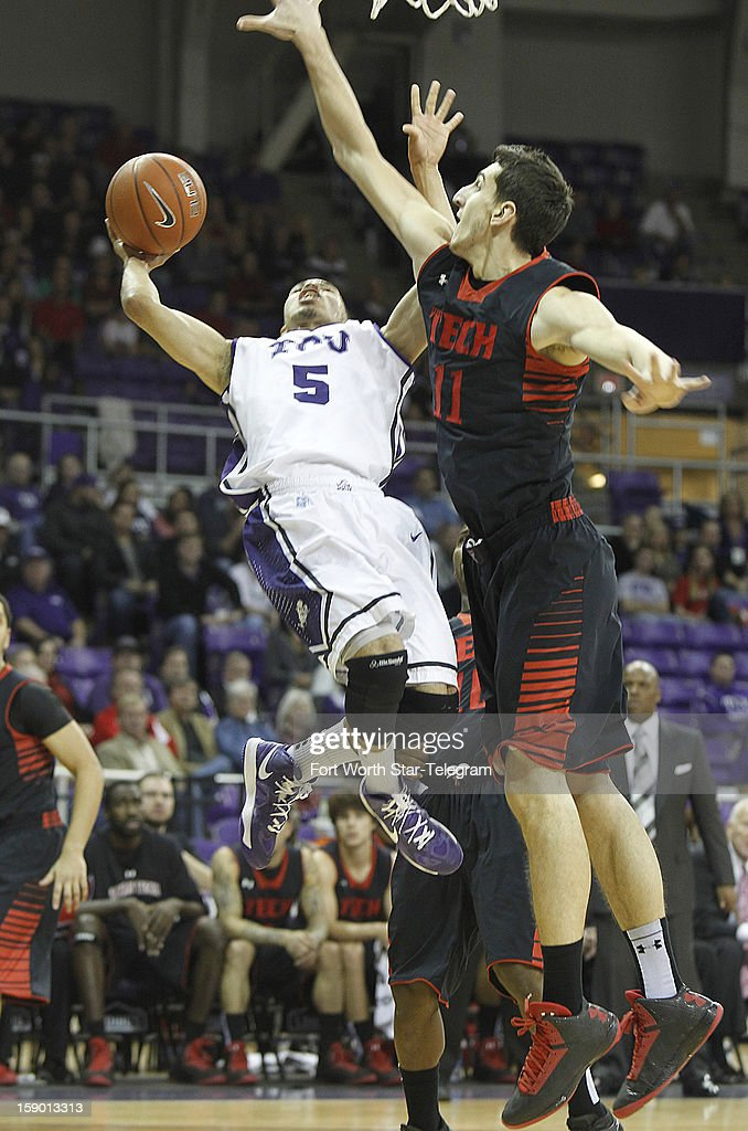 Texas Tech's Dejan Kravic (11) blocks a shot by Texas Christian University's Kyan Anderson (5) in the first half at Daniel-Meyer Coliseum in Fort Worth, Texas, Saturday, January 5, 2013. Texas Tech defeated TCU, 62-53.