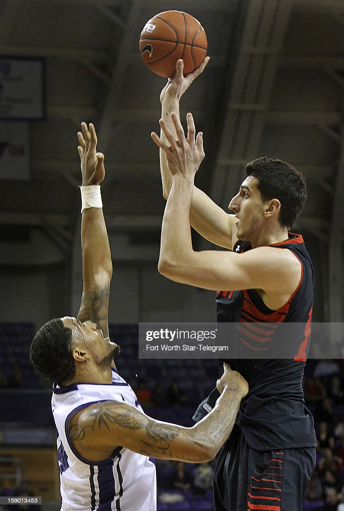 Texas Tech's Dejan Kravic, right, shoots over Texas Christian University defender Adrick McKinney in the second half at Daniel-Meyer Coliseum in Fort Worth, Texas, Saturday, January 5, 2013. Texas Tech defeated TCU, 62-53.