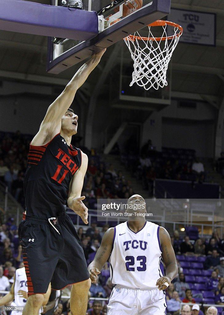 Texas Tech's Dejan Kravic (11) scores against Texas Christian University defender Devonta Abron (23) in the second half at Daniel-Meyer Coliseum in Fort Worth, Texas, Saturday, January 5, 2013. Texas Tech defeated TCU, 62-53.
