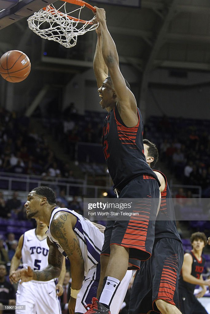 Texas Tech's Jordan Tolbert dunks over Texas Christian Univeristy's Adrick McKinney (24) in the second half at Daniel-Meyer Coliseum in Fort Worth, Texas, Saturday, January 5, 2013. Texas Tech defeated TCU, 62-53.