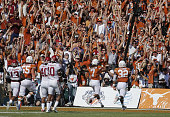 Texas wide receiver Marcus Johnson scores a touchdown on a 24yard reception during the first half against Oklahoma at the Cotton Bowl in Dallas on...