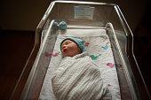 USA, Texas, Williamson county, Newborn baby in hospital crib