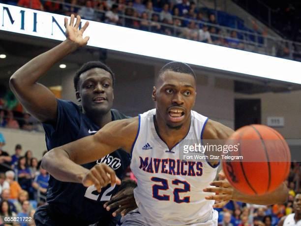 TexasArlington Mavericks center Link Kabadyundi leaps for a rebound with Akron Zips forward Emmanuel Olojakpoke behind him in the first half during...