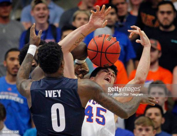 TexasArlington Mavericks forward Jorge Bilbao and Akron Zips guard Jimond Ivey battle for a loose ball under the net in the first half during their...