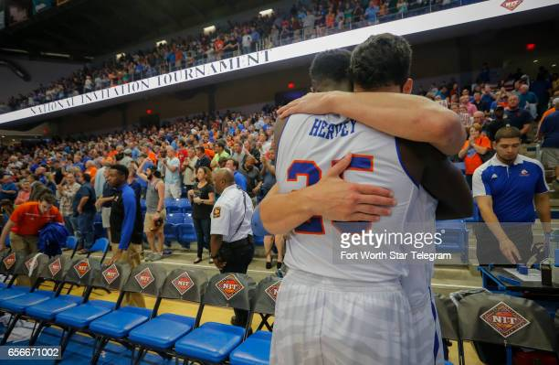 TexasArlington's Kevin Hervey and teammate Jorge Bilbao embrace after a 8076 loss against Cal State Bakersfield in a National Invitation Tournament...