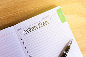 Text Action plan on Notepad - New Year Concept