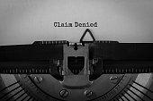 Text Claim Denied typed on retro typewriter