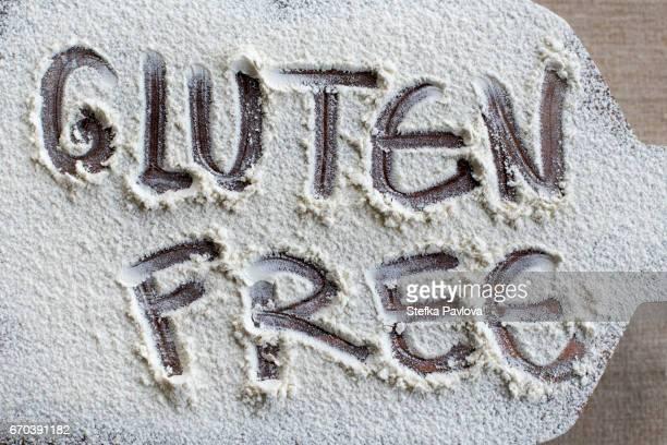 text GLUTEN FREE written on powdered cutting board