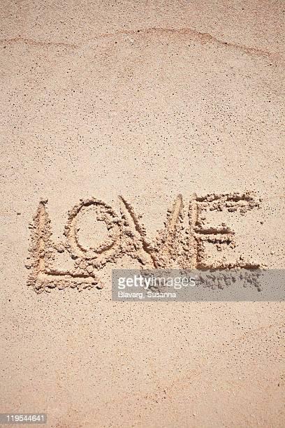 Text Love written on sand