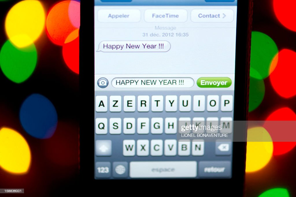 A text message (SMS) of New Year greetings in English is pictured on a smartphone on December 31, 2012 in Paris. Millions of SMS should be sent in the world on January 1, 2013.