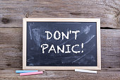 DON'T PANIC! Text on blackboard