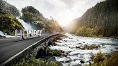 Text on bridge in scenic landscape