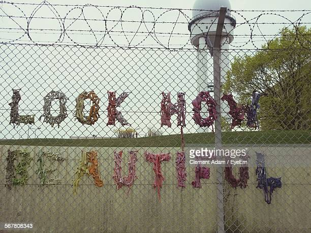 Text On Fence Against Radar Tower