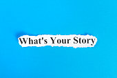 WHAT'S YOUR STORY text on paper. Word WHAT'S YOUR STORY on torn paper. Concept Image.