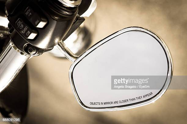 Text On Side-View Mirror Of Motorcycle