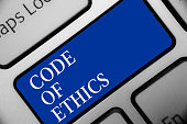 Text sign showing Code Of Ethics. Conceptual photo Moral Rules Ethical Integrity Honesty Good procedure Keyboard blue key Intention create computer computing reflection document