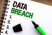 Text sign showing Data Breach. Conceptual photo Stolen Cybercrime Information Hacking Security Malicious Crack written Notebooke Book the jute background Marker next to it.
