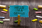 Text sign showing Hello I am A Genius. Conceptual photo Introduce yourself as over average person to others Clips symbol idea script notice board text capital cardboard design