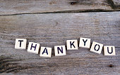 Text: Thankyou from wooden letters on wooden background