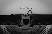 Text True Story typed on retro typewriter