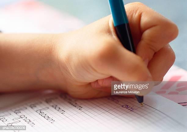 Textbook and ballpoint  pen.
