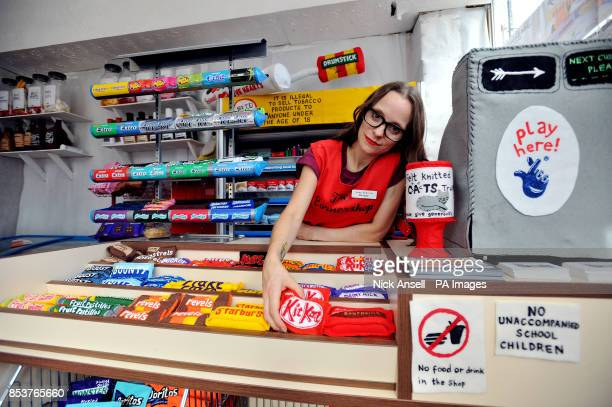 Textile artist Lucy Sparrow adjusts some handmade felt groceries on the counter of her art installation The Cornershop in Wellington Row Bethnal...