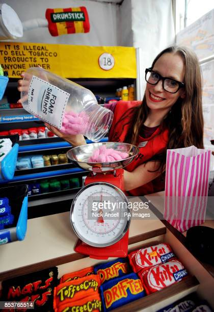 Textile artist Lucy Sparrow measures out some handmade foam shrimps on the counter of her art installation The Cornershop in Wellington Row Bethnal...