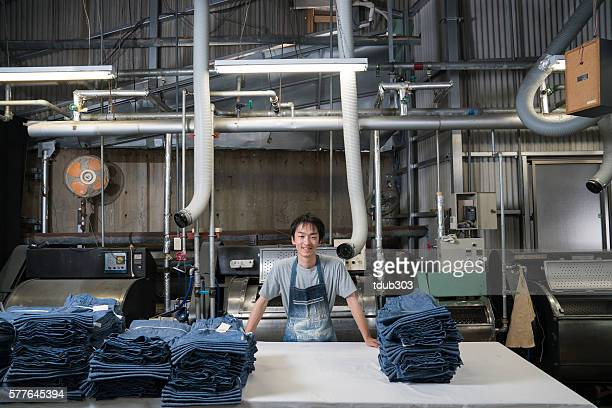 textile industry worker checking inventory before shipping